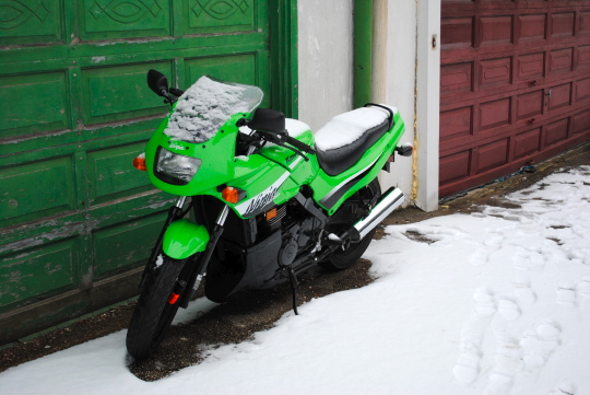 [motorcycle lightly covered with snow]