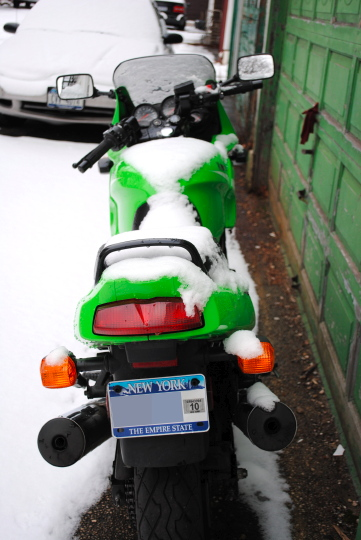 [snow-backed motorcycle, hind view]
