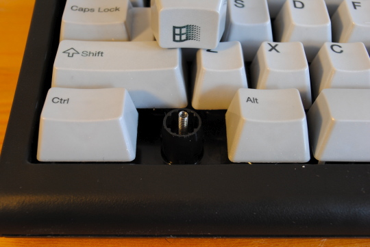 [pulled windows keycaps revealing spring]